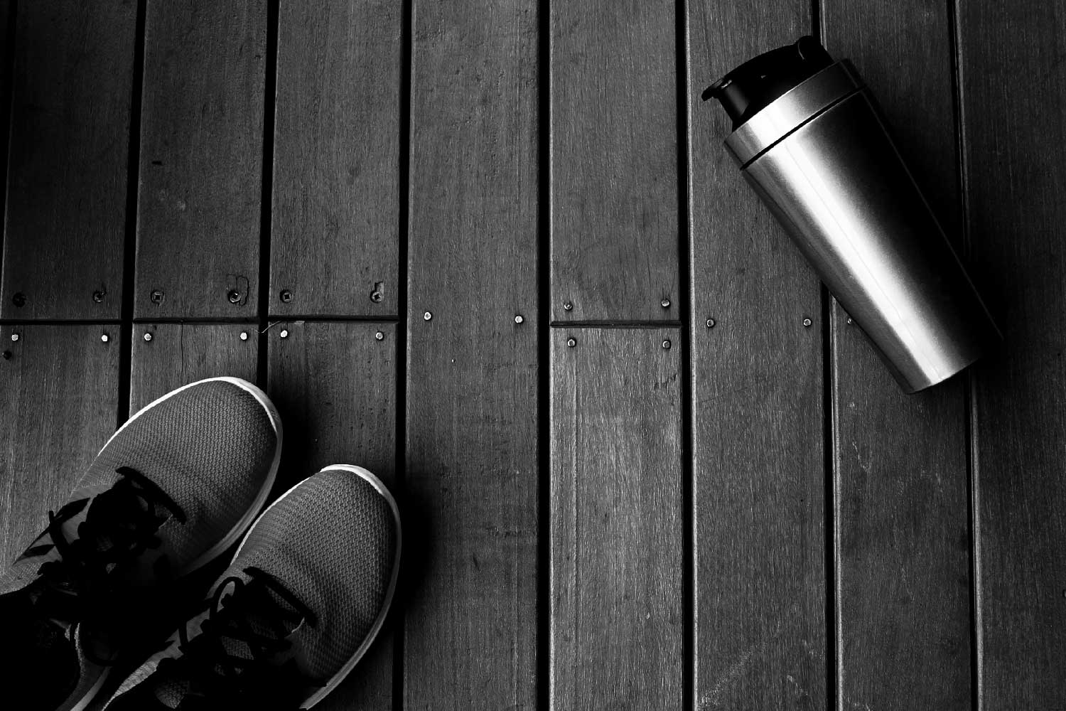 homepage background of gym shoes and a shaker bottle.